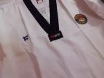 Baju Seragam dobok Taekwondo Empro kerah hitam harga 200 rb , kerah putih harga 150 rb,  motif salur kebawah cotton 45% ,55% polyster